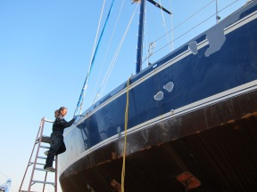 Repairing the dings on the hull.